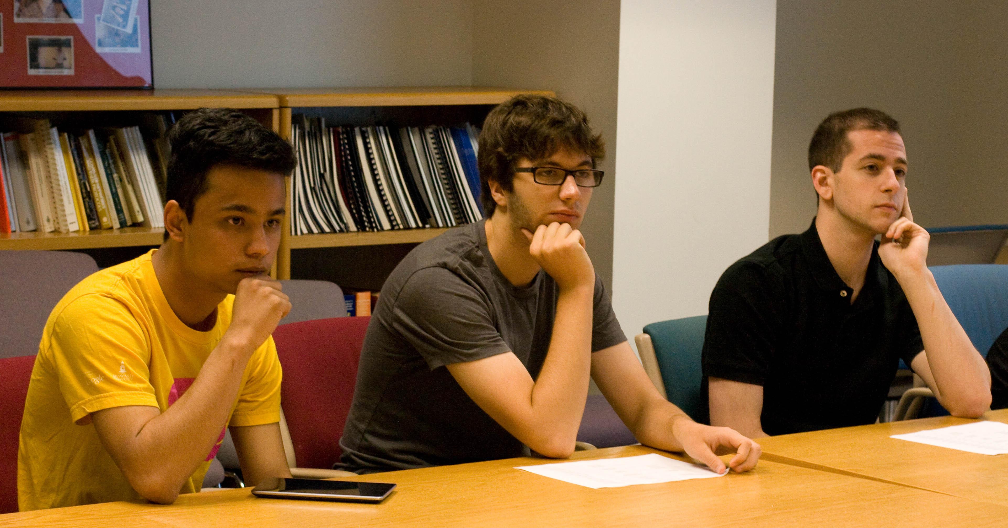 REU students Roshan       Thapaliya (left), Jacob McNamara (center), and Leo Behe (right).